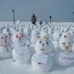 An army of snowmen, mostly made by children supervised by the volunteers.